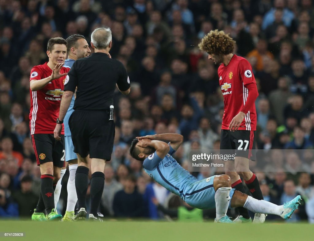 Marouane Fellaini of Manchester United clashes with Sergio Aguero of Manchester City during the Premier League match between Manchester City and Manchester United at Etihad Stadium on April 27, 2017 in Manchester, England.