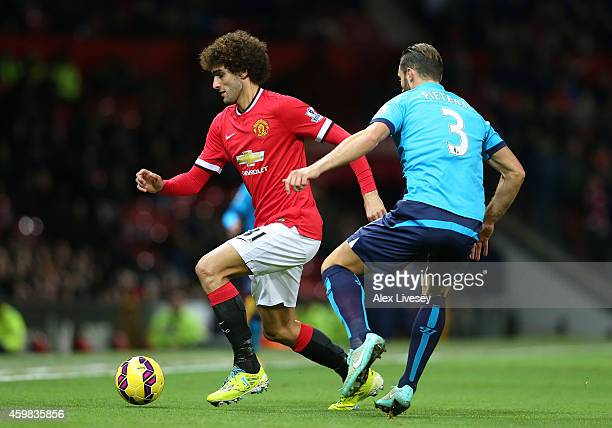 Marouane Fellaini of Manchester United competes with Erik Pieters of Stoke City during the Barclays Premier League match between Manchester United...