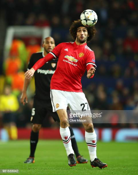 Marouane Fellaini of Manchester United controls the ball during the UEFA Champions League Round of 16 Second Leg match between Manchester United and...