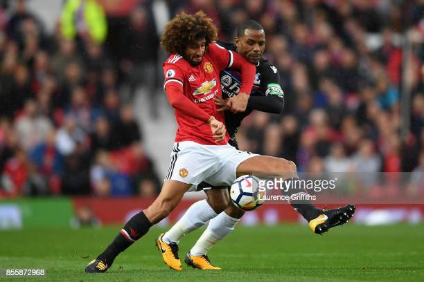 Marouane Fellaini of Manchester United controls the ball under pressure of Jason Puncheon of Crystal Palace during the Premier League match between...