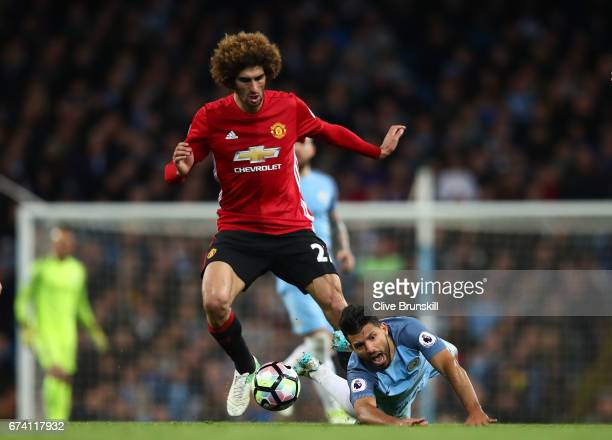 Marouane Fellaini of Manchester United fouls Sergio Aguero of Manchester City in the build up to Marouane Fellaini being shown a red card during the...