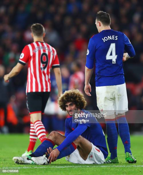 Marouane Fellaini of Manchester United goes down injured during the Premier League match between Southampton and Manchester United at St Mary's...