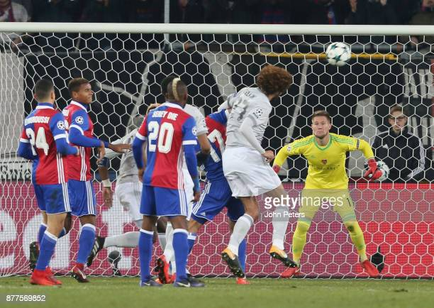 Marouane Fellaini of Manchester United has a header on goal during the UEFA Champions League group A match between FC Basel and Manchester United at...