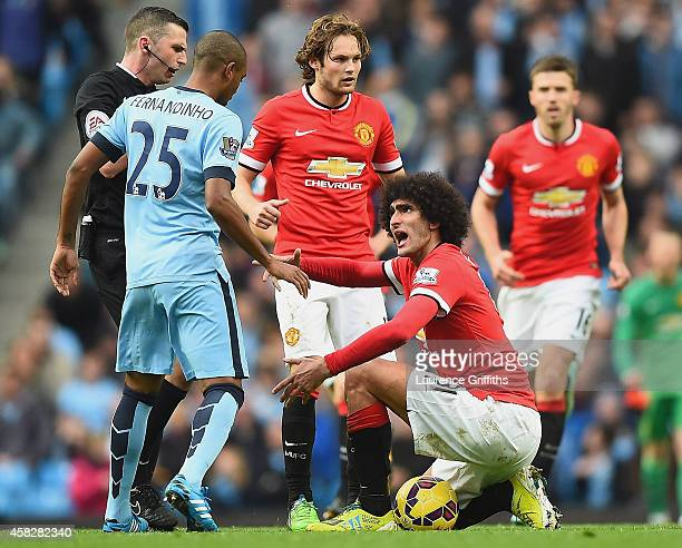 Marouane Fellaini of Manchester United has words with Fernandinho of Manchester City during the Barclays Premier League match between Manchester City...