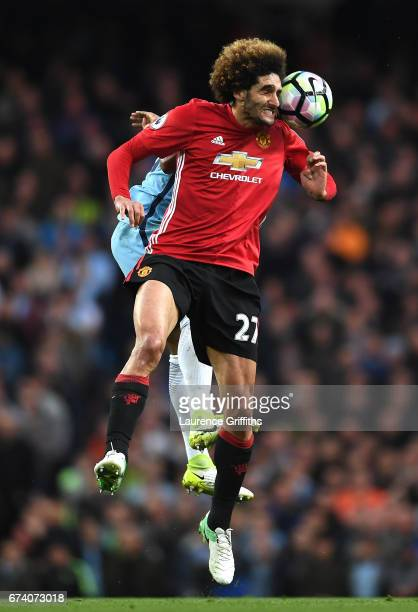 Marouane Fellaini of Manchester United heads the ball under pressure during the Premier League match between Manchester City and Manchester United at...