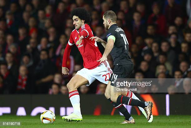 Marouane Fellaini of Manchester United holds off Jordan Henderson of Liverpool during the UEFA Europa League round of 16 second leg match between...