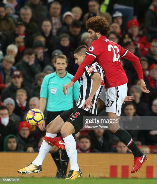 Marouane Fellaini of Manchester United in action with Aleksandar Mitrovic of Newcastle United during the Premier League match between Manchester...