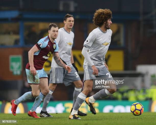 Marouane Fellaini of Manchester United in action with Ashley Barnes of Burnley during the Premier League match between Burnley and Manchester United...