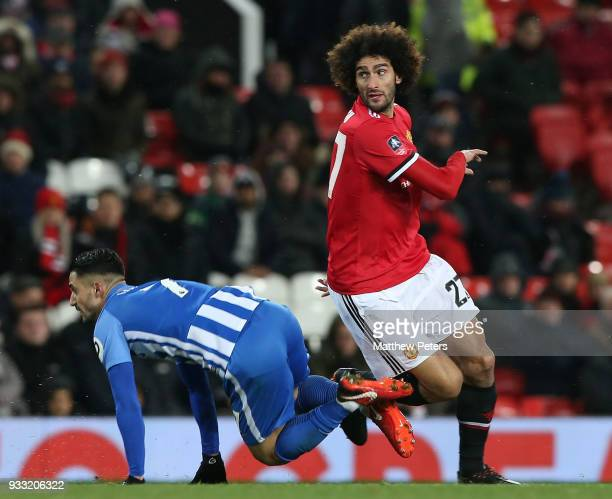 Marouane Fellaini of Manchester United in action with Beram Kayal of Brighton Hove Albion during the Emirates FA Cup Quarter Final match between...