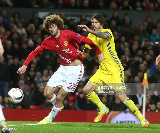 Marouane Fellaini of Manchester United in action with Cesar Navas of FK Rostov during the UEFA Europa League Round of 16 second leg match between...