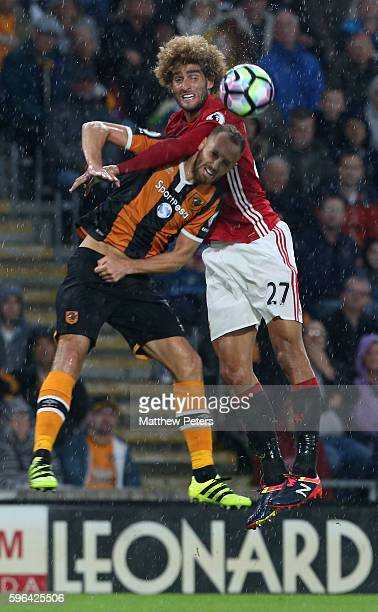 Marouane Fellaini of Manchester United in action with David Meyler of Hull City during the Premier League match between Manchester United and Hull...