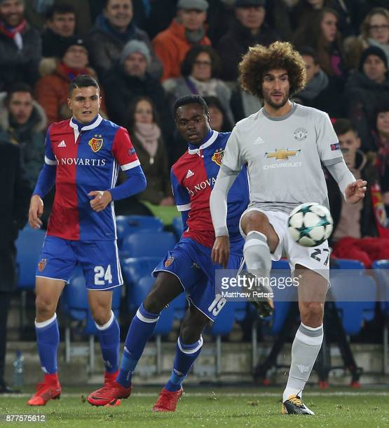 Marouane Fellaini of Manchester United in action with Dimitri Oberlin of FC Basel during the UEFA Champions League group A match between FC Basel and...