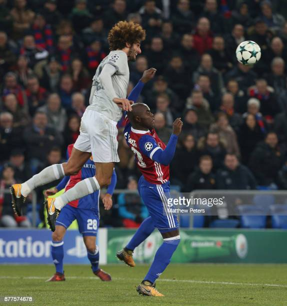 Marouane Fellaini of Manchester United in action with Eder Balanta of FC Basel during the UEFA Champions League group A match between FC Basel and...
