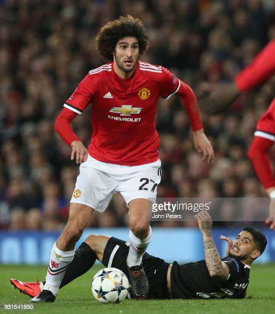 Marouane Fellaini of Manchester United in action with Ever Banega of Sevilla FC during the UEFA Champions League Round of 16 Second Leg match between...