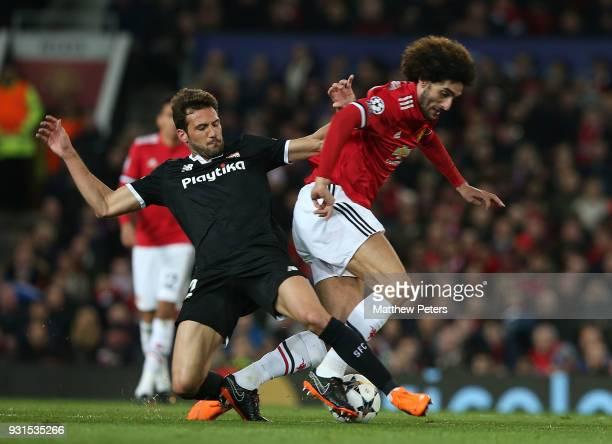 Marouane Fellaini of Manchester United in action with Franco Vazquez of Sevilla FC during the UEFA Champions League Round of 16 Second Leg match...