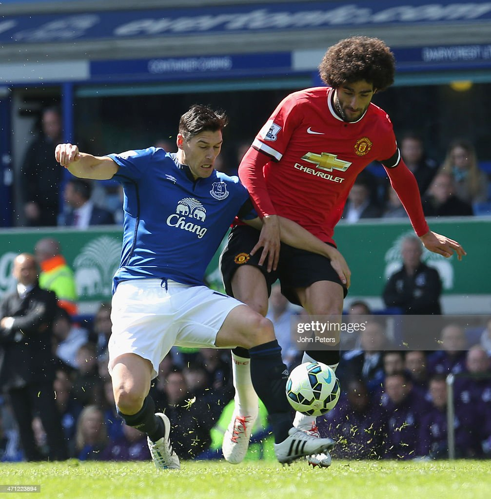 Marouane Fellaini of Manchester United in action with Gareth Barry of Everton during the Barclays Premier League match between Everton and Manchester United at Goodison Park on April 26, 2015 in Liverpool, England.