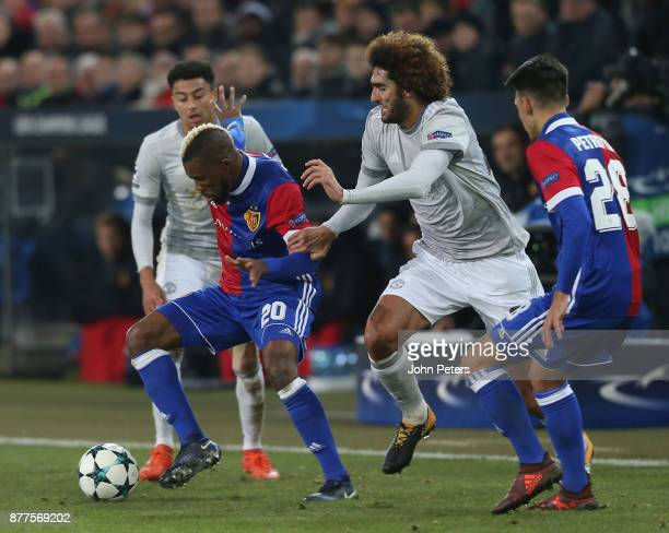 Marouane Fellaini of Manchester United in action with Geoffroy Serey Die of FC Basel during the UEFA Champions League group A match between FC Basel...