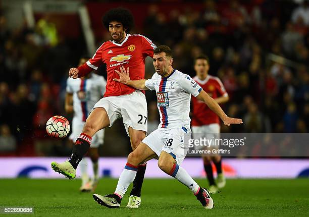 Marouane Fellaini of Manchester United in action with James McArthur of Crystal Palace during the Barclays Premier League match between Manchester...
