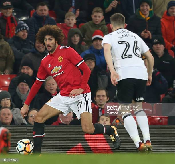 Marouane Fellaini of Manchester United in action with Jamie Hanson of Derby County during the Emirates FA Cup Third Round match between Manchester...