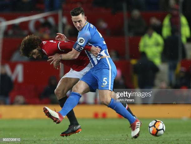 Marouane Fellaini of Manchester United in action with Lewis Dunk of Brighton Hove Albion during the Emirates FA Cup Quarter Final match between...