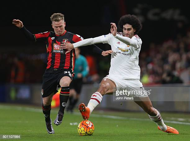 Marouane Fellaini of Manchester United in action with Matt Ritchie of AFC Bournemouth during the Barclays Premier League match between AFC...