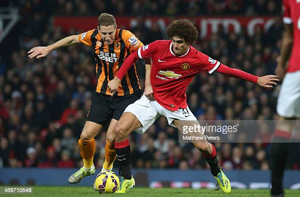 Marouane Fellaini of Manchester United in action with Michael Dawson of Hull City during the Barclays Premier League match between Manchester United...