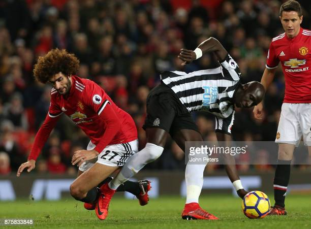 Marouane Fellaini of Manchester United in action with Mohamed Diame of Newcastle United during the Premier League match between Manchester United and...