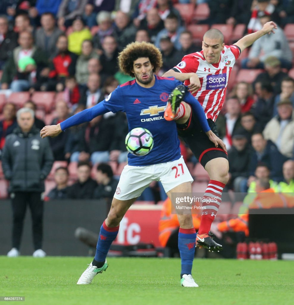 Marouane Fellaini of Manchester United in action with Oriol Romeu of Southampton during the Premier League match between Southampton and Manchester United at St Mary's Stadium on May 17, 2017 in Southampton, England.