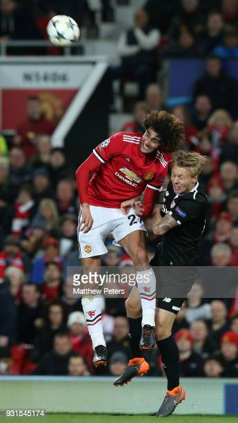 Marouane Fellaini of Manchester United in action with Simon Kjaer of Sevilla FC during the UEFA Champions League Round of 16 Second Leg match between...