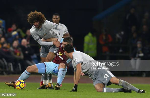 Marouane Fellaini of Manchester United in action with SSam Vokes of Burnley during the Premier League match between Burnley and Manchester United at...