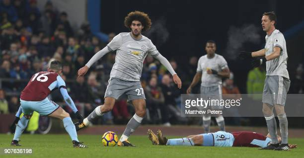 Marouane Fellaini of Manchester United in action with Steven Defour of Burnley during the Premier League match between Burnley and Manchester United...