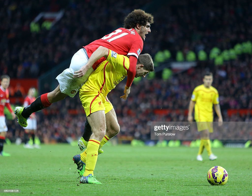 Marouane Fellaini of Manchester United in action with Steven Gerrard of Liverpool during the Barclays Premier League match between Manchester United and Liverpool at Old Trafford on December 14, 2014 in Manchester, England.
