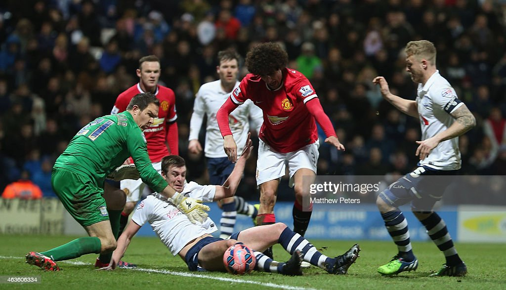Marouane Fellaini of Manchester United in action with Thorsten Stuckmann and Tom Clarke of Preston North End during the FA Cup Fifth Round match between Preston North End and Manchester United at Deepdale on February 16, 2015 in Preston, England.