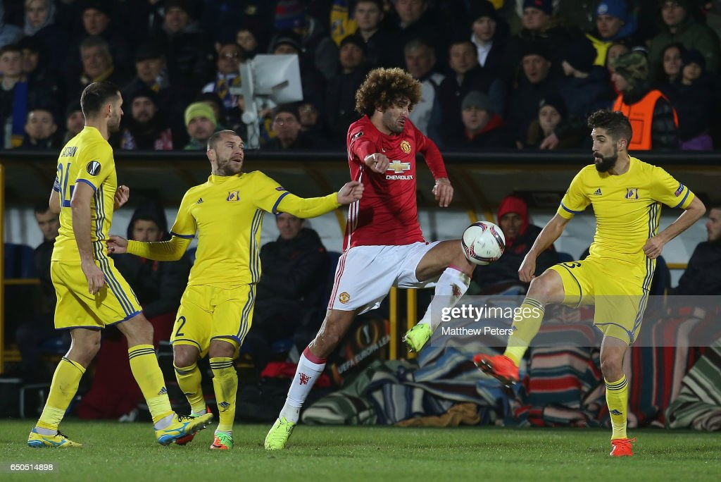Marouane Fellaini of Manchester United in action with Timofei Kalachev and Miha Mevlja of FK Rostov during the UEFA Europa League Round of 16 first leg match between FK Rostov and Manchester United at Olimp-2 on March 9, 2017 in Rostov-on-Don, Russia.