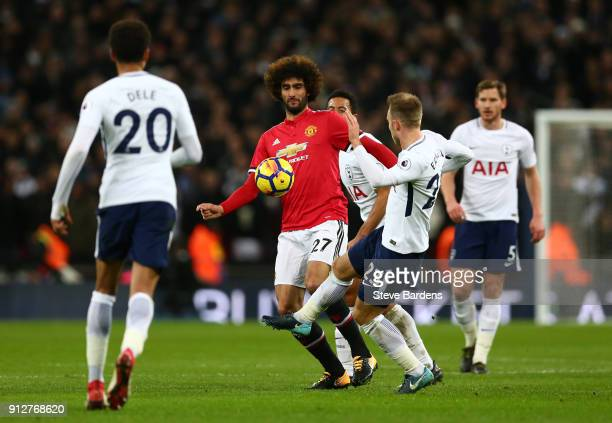 Marouane Fellaini of Manchester United is challenged by Christian Eriksen of Tottenham Hotspur during the Premier League match between Tottenham...