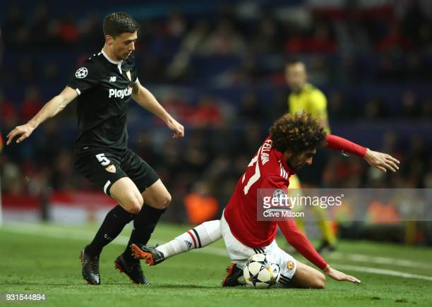 Marouane Fellaini of Manchester United is challenged by Clement Lenglet of Sevilla during the UEFA Champions League Round of 16 Second Leg match...