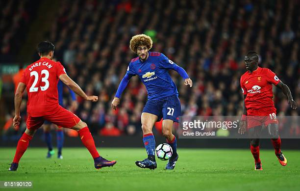 Marouane Fellaini of Manchester United is closed down by Emre Can and Sadio Mane of Liverpool during the Premier League match between Liverpool and...