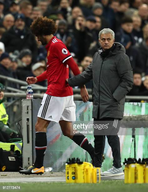 Marouane Fellaini of Manchester United is embraced by Jose Mourinho Manager of Manchester United during the Premier League match between Tottenham...