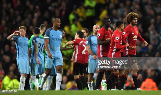 Marouane Fellaini of Manchester United is escorted off the pitch by his team mates after being shown a red card during the Premier League match...