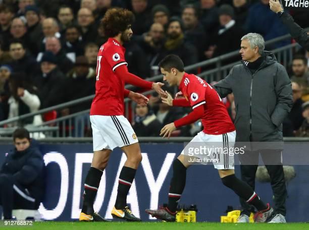Marouane Fellaini of Manchester United is replaced by Ander Herrera of Manchester United during the Premier League match between Tottenham Hotspur...
