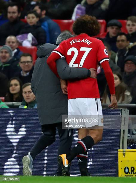 Marouane Fellaini of Manchester United is replaced by Jose Mourinho Manager of Manchester United during the Premier League match between Tottenham...
