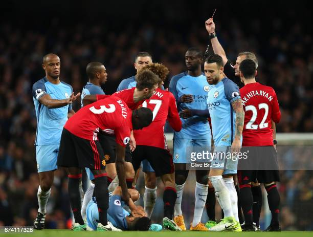 Marouane Fellaini of Manchester United is shown a red card during the Premier League match between Manchester City and Manchester United at Etihad...