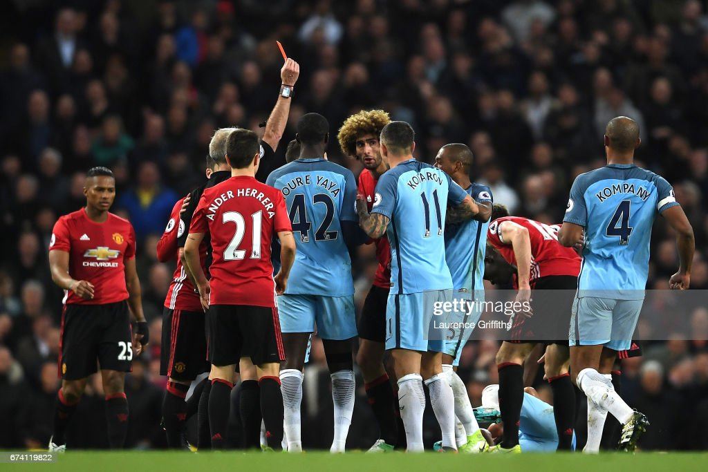 Marouane Fellaini of Manchester United is shown a red card following a clash with Sergio Aguero of Manchester Cityduring the Premier League match between Manchester City and Manchester United at Etihad Stadium on April 27, 2017 in Manchester, England.