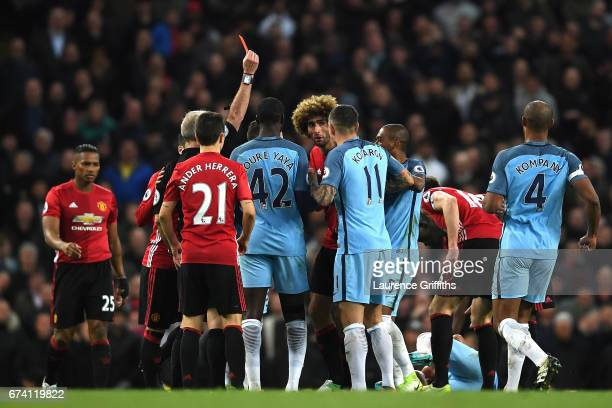 Marouane Fellaini of Manchester United is shown a red card following a clash with Sergio Aguero of Manchester Cityduring the Premier League match...