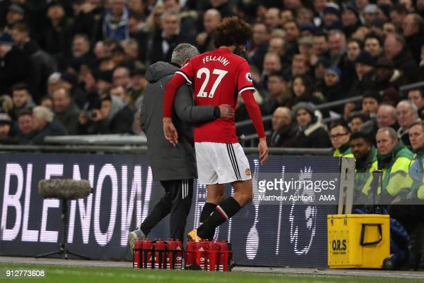 Marouane Fellaini of Manchester United is substituted by Manchester United Head Coach / Manager Jose Mourinho after coming on as a substitute during...