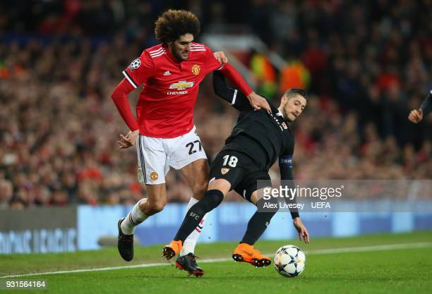 Marouane Fellaini of Manchester United is tackled by Sergio Escudero of Sevilla FC during the UEFA Champions League Round of 16 Second Leg match...