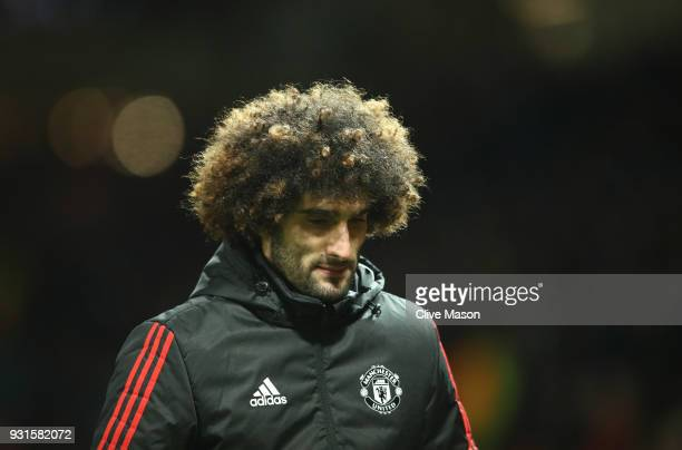 Marouane Fellaini of Manchester United looks dejected in defeat after the UEFA Champions League Round of 16 Second Leg match between Manchester...