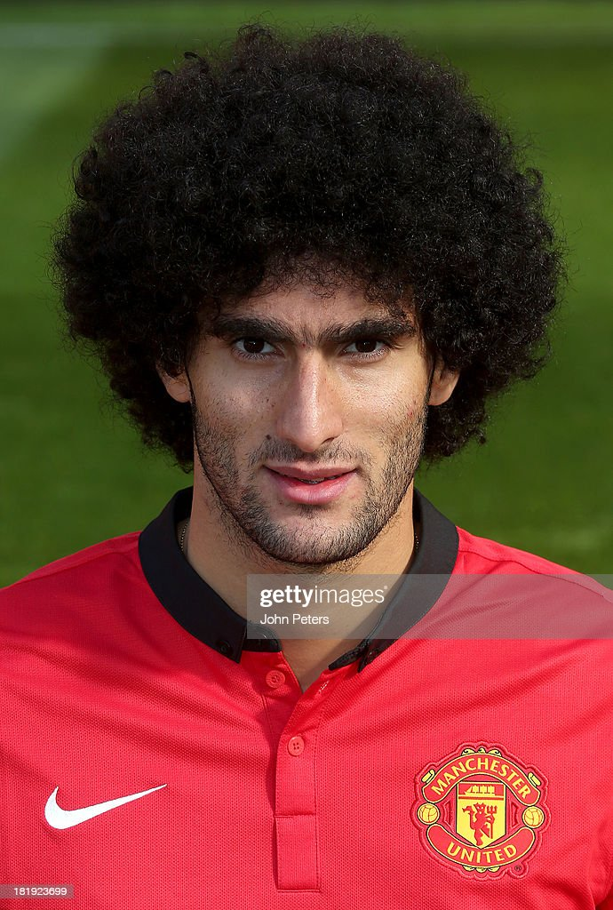 Marouane Fellaini of Manchester United poses at the annual club photocall at Old Trafford on September 26, 2013 in Manchester, England.