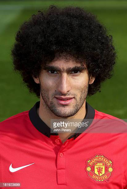 Marouane Fellaini of Manchester United poses at the annual club photocall at Old Trafford on September 26 2013 in Manchester England