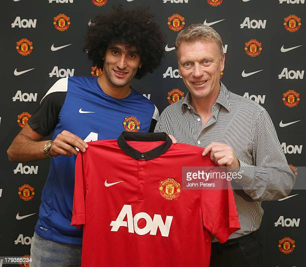 Marouane Fellaini of Manchester United poses with Manager David Moyes after signing for the club at Aon Training Complex on September 2, 2013 in...